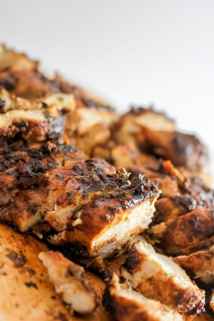 greek chicken breast on wooden board