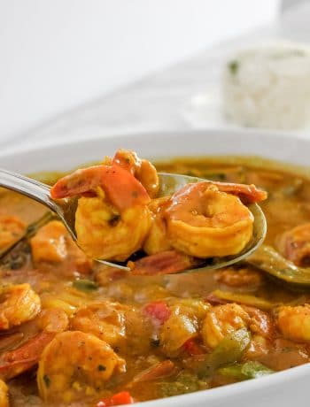 Jamaican Curry Shrimp in White Dish with Red and Green Bell Peppers in Spoon