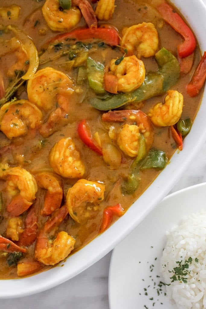 Jamaican Curry Shrimp in White Dish with Red and Green Bell Peppers