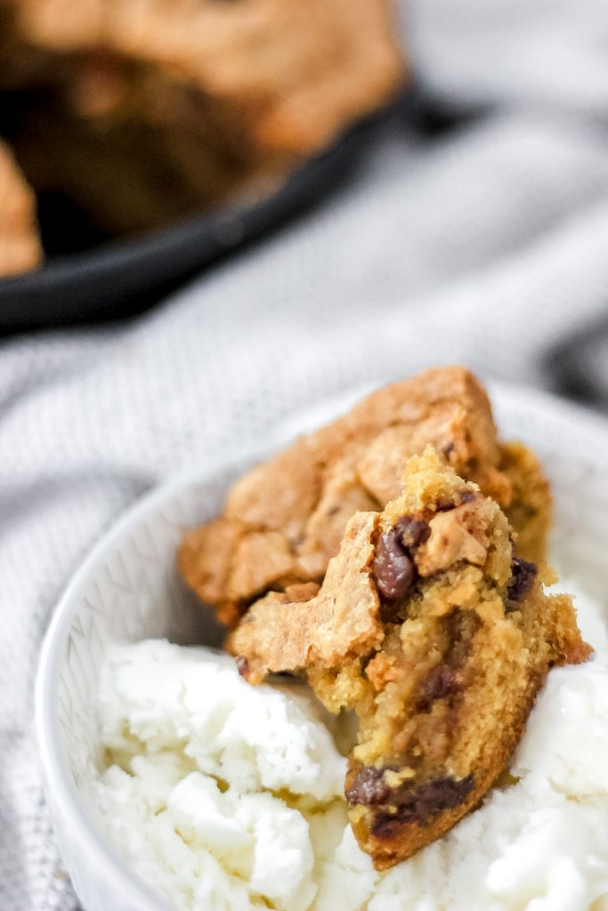 Sea Salt Chocolate Chip Skillet Cookie in bowl with ice cream