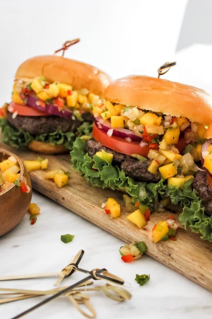 3 Jerk Burgers with Pineapple Mango Salsa on Wooden Plank