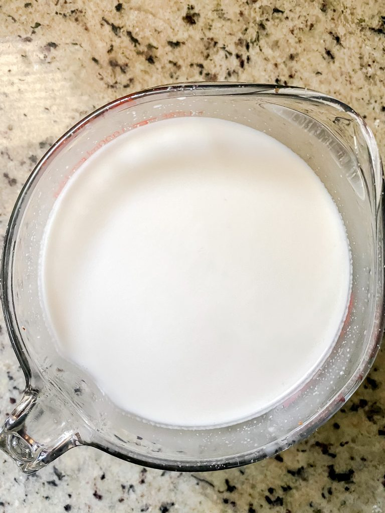 Fresh Almond Milk in Measuring Cup
