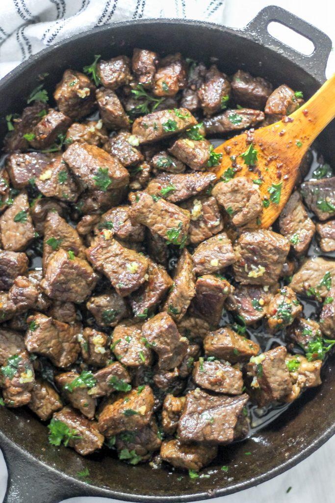 Easy Garlic Butter Steak Bites Overhead shot in Skillet