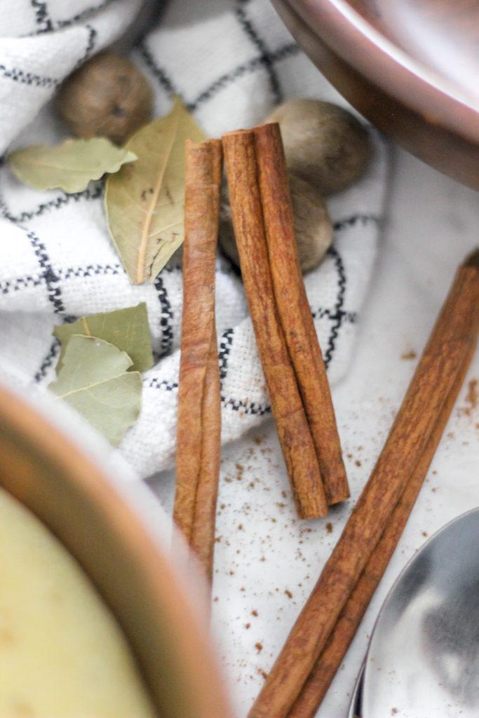Cinnamon Sticks and Bay Leaves on Black and White Tea Towel