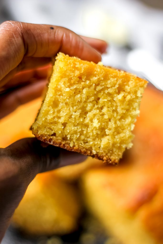 Easy Classic Buttermilk Cornbread slice in hand