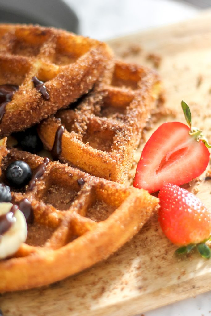 Churro Waffles with Strawberries & Blueberries on Wooden Board