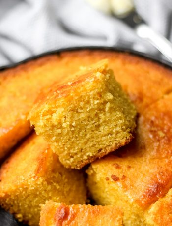 Easy Classic Buttermilk Cornbread in skillet cut into squares