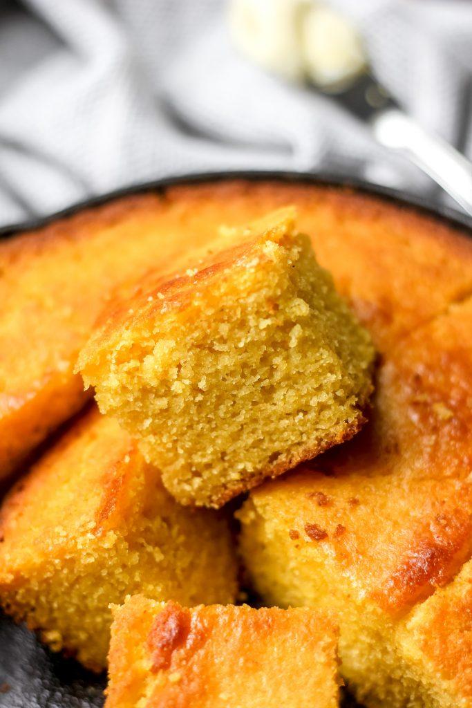Easy Classic Buttermilk Cornbread in skillet cut into squares