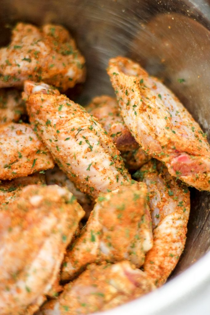 Raw Seasoned Chicken Wings in Bowl