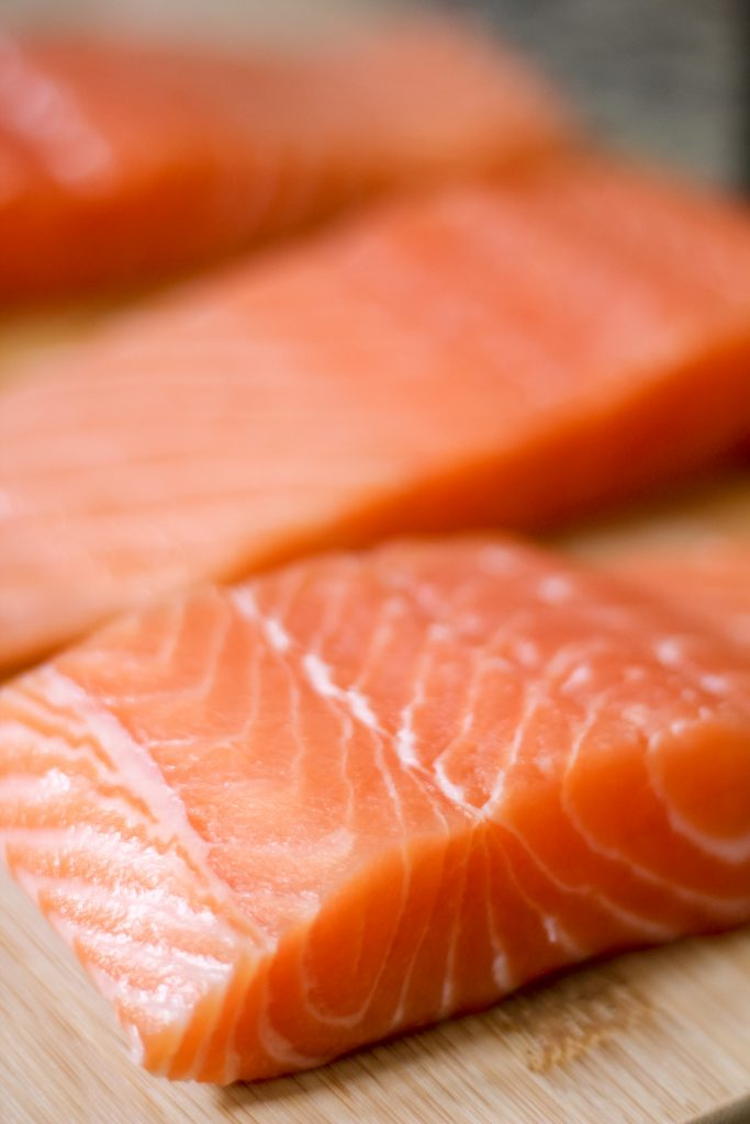Salmon Fillets on Wooden Cutting Board