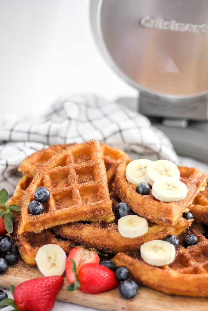 Light & Fluffy Churro Waffles with Cuisinart Waffle Iron in Back