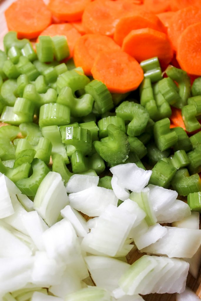 Carrots, Onions and Celery on chopping board