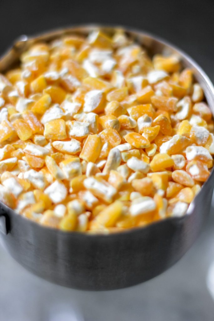 Dry Hominy Corn Kernels in Measuring Cup