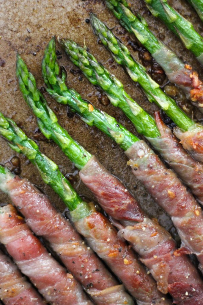 Garlic Butter Prosciutto Wrapped Asparagus on baking tray_Featured Image
