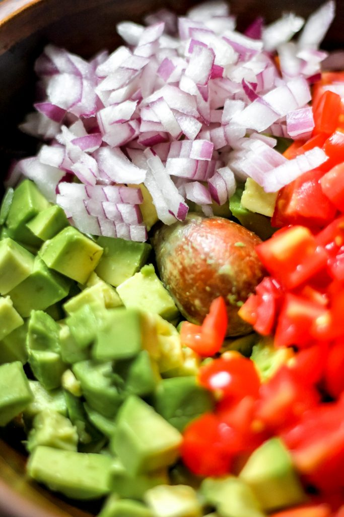 Avocado, Red Onion, Tomatoes in Bowl Chopped