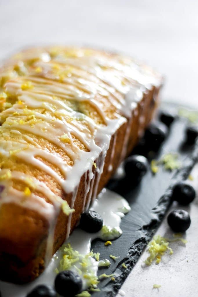Blueberry Lemon Loaf with Lemon Glaze dripping down sides