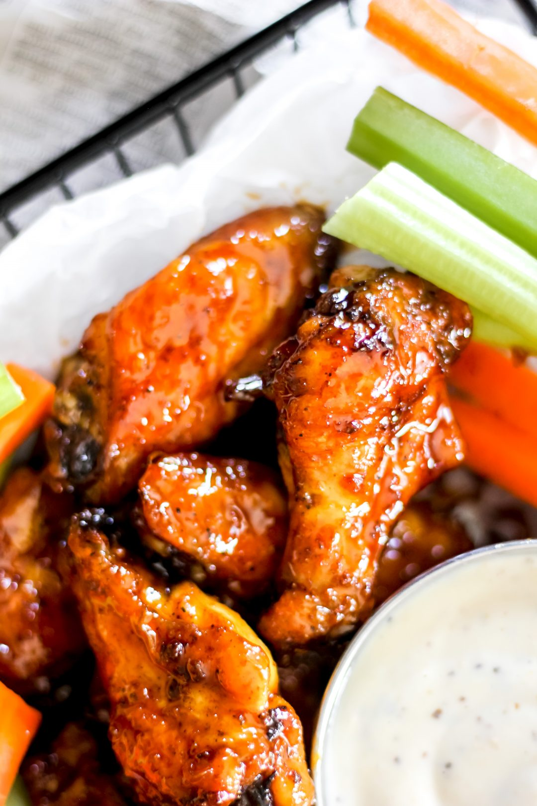 Air-Fryer Sticky Honey Garlic Chicken Wings in Basket with Carrots and Celery