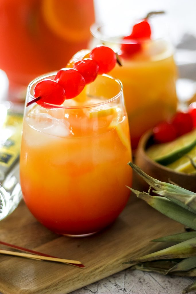 Tropical Rum Punch in Glass on Wooden Plank