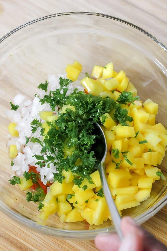 Jerk Burgers with Pineapple Mango Salsa - Adding Fresh Herbs