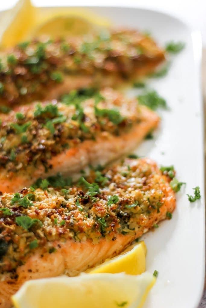 3 Salmon Fillets on Plate with Lemon Garnish