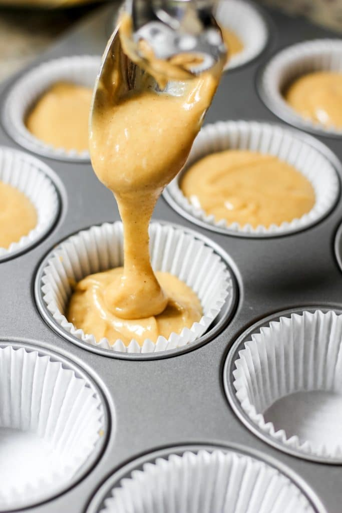 Pouring Easy Coffee Cake Muffins Batter in Muffin Tray